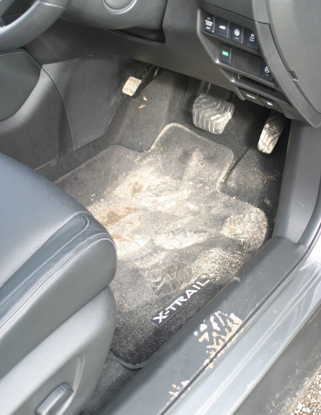 Nissan X-Trail Ti with muddy foot prints on carpet