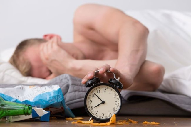 Man with hangover - Copyright: Katarzyna Bialasiewicz