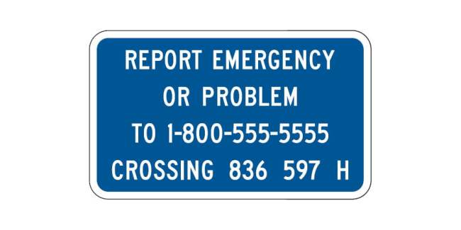 The blue railroad crossing information sign