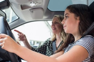 teen getting driving test tips from an instructor