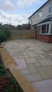 A natural smooth sand stone patio with locally machined Bramley fall sand stone copings and Bull nosed step treads.This work was recently completed in Cross Gates,Leeds. Marshalls Paving.