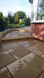 Recently completed Patio areas in Cross Gates,Leeds. This work was completed in a Marshall,s smooth sand stone paving with Bramley fall locally machined sand stone copings.