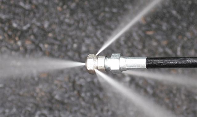 Driveway cleaning with a power wash jet washer