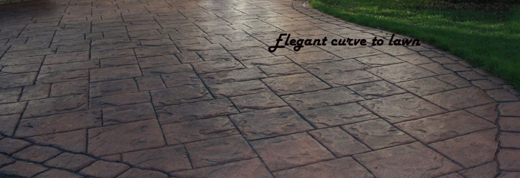 pattern imprinted concrete curved edging to lawn
