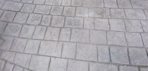 Steel grey colour pattern imprinted concrete driveway
