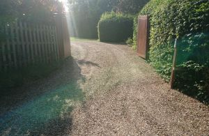 sweeping gravel driveway