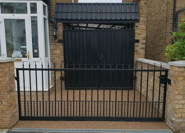 Resin Bound Surfacing Specialists finished resin driveway with gate and garage door in London