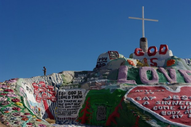 Paint, dirt, and a lot of Jesus love. Paul checks in atop Salvation Mountain.