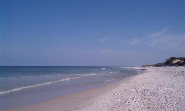 White sand beach, sailboat on the horizon. Not a bad Monday so far.