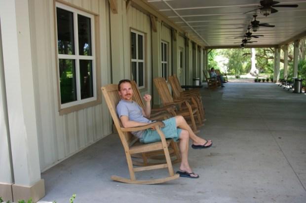 Paul settin' for a spell on the veranda.