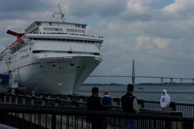 A cruise ship about to depart.