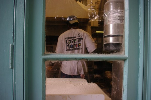 Walk around the back of the shop and you can see the beignets being made.