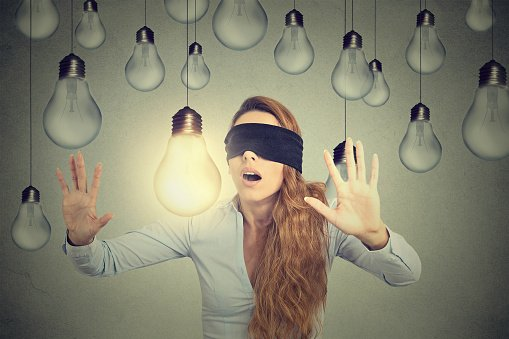 blind folded woman with light bulbs