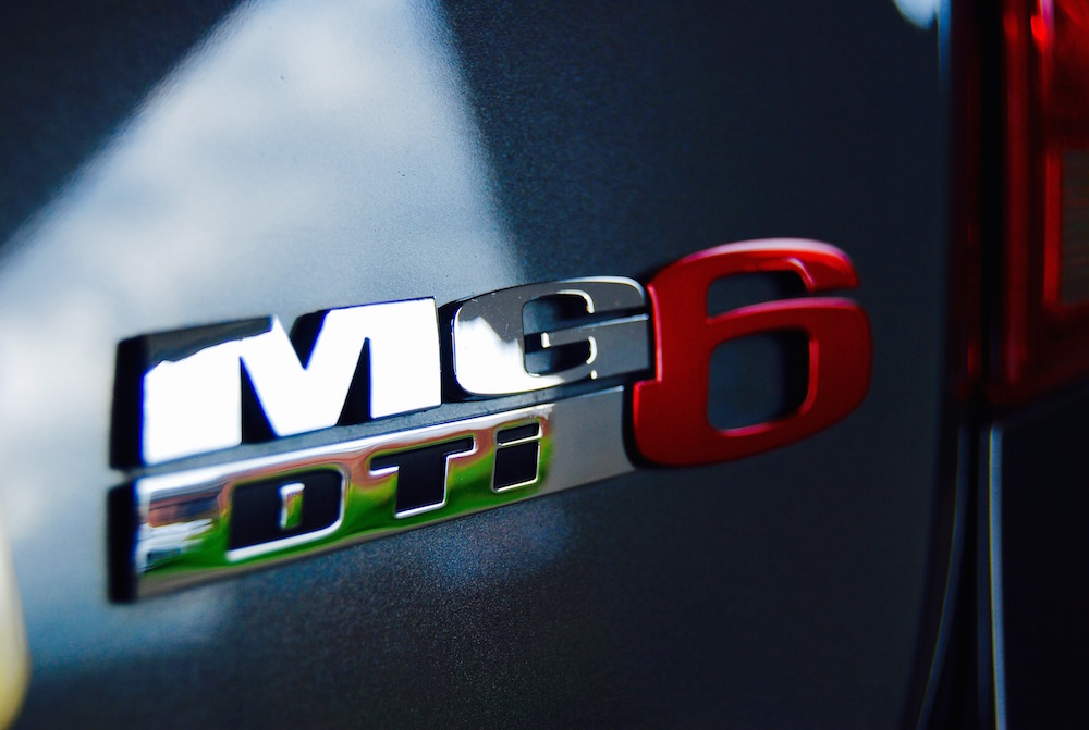 mg6 dti badge