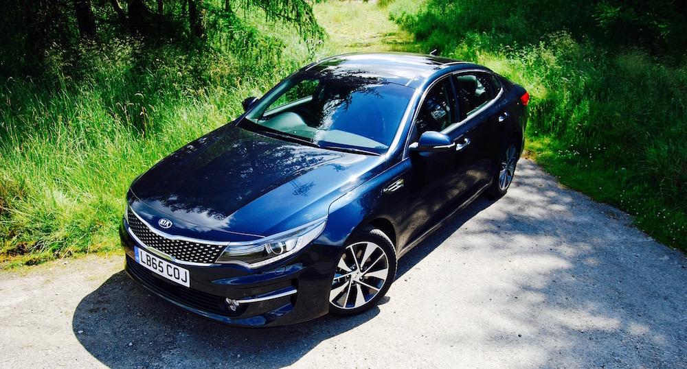kia optima review front side blue