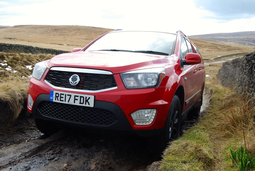 ssangyong musso red off road front side