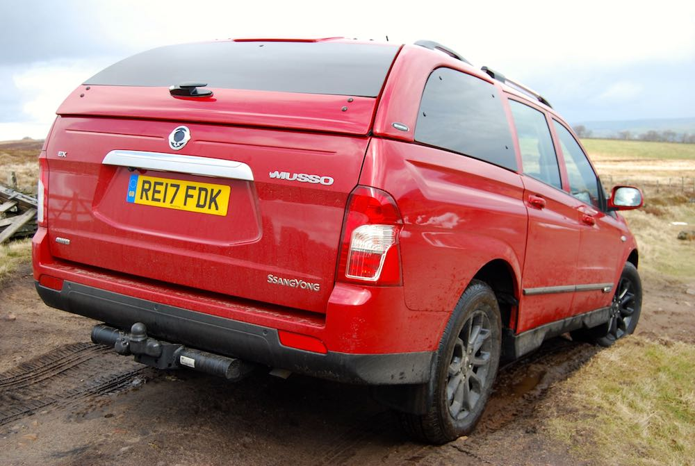 ssangyong musso red off road rear side