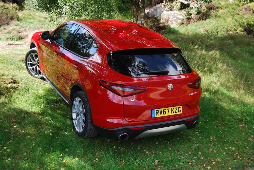 alfa romeo stelvio red rear side review roadtest