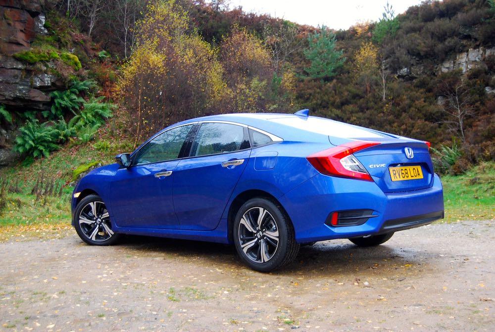 honda civic 4 door blue rear side