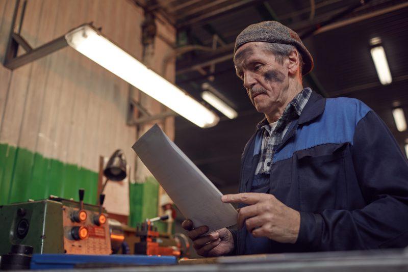 Worker reading his repair manual.