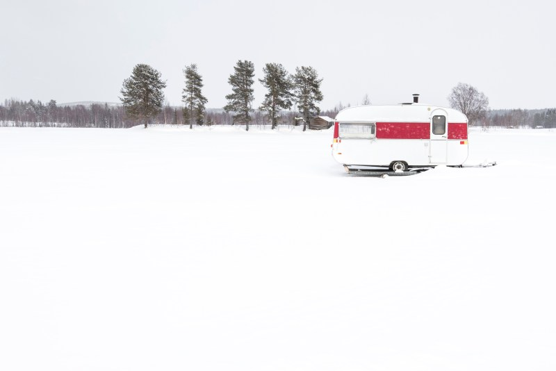 RV covers use in off season to protect against rain, leaves and snow