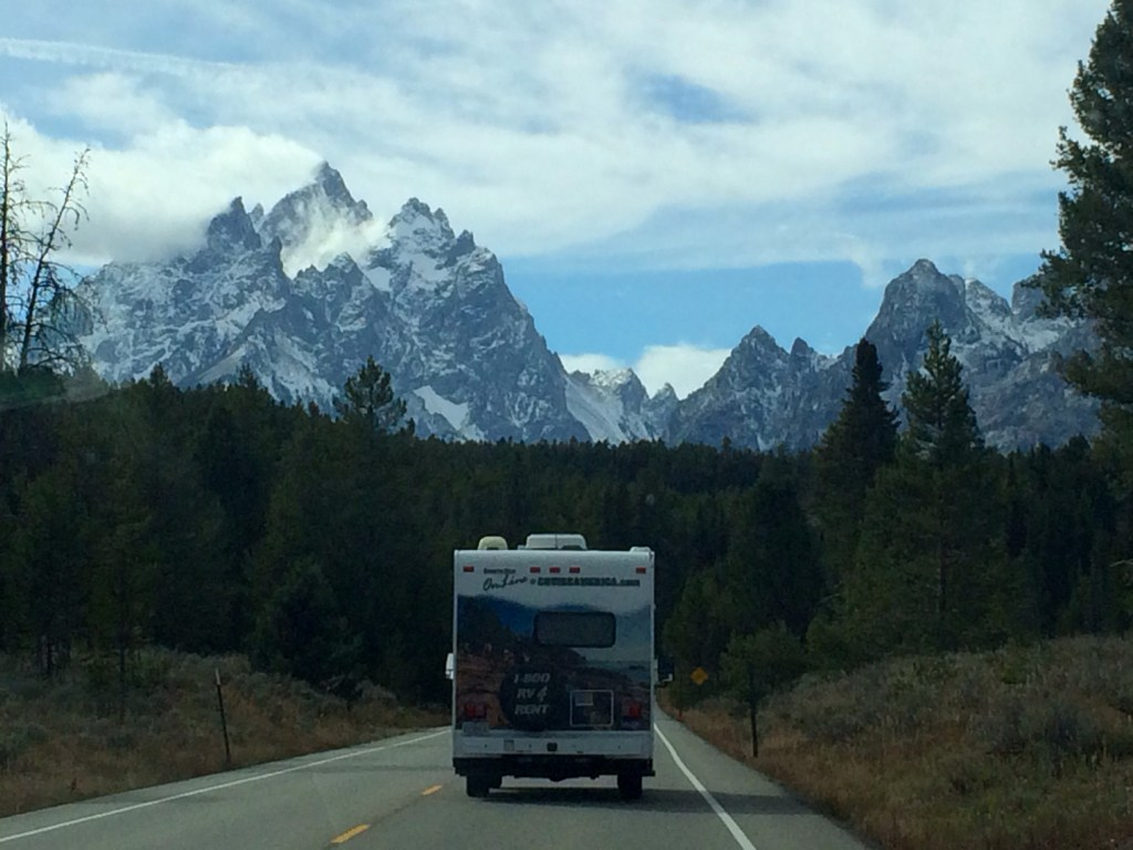RV driving towards snowy mountains