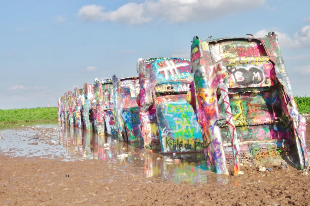 Cadillacs in mud.