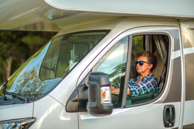 Woman driving RV.