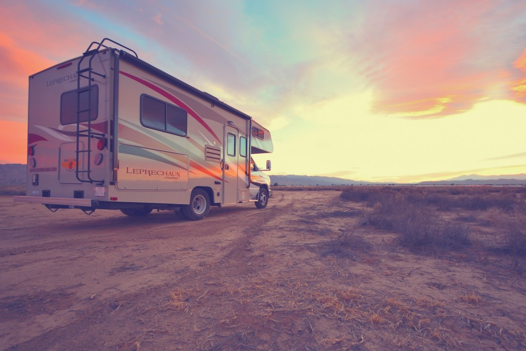 RV parked at sunset.