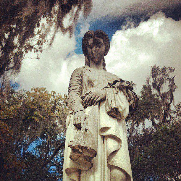 Female statue in cemetery