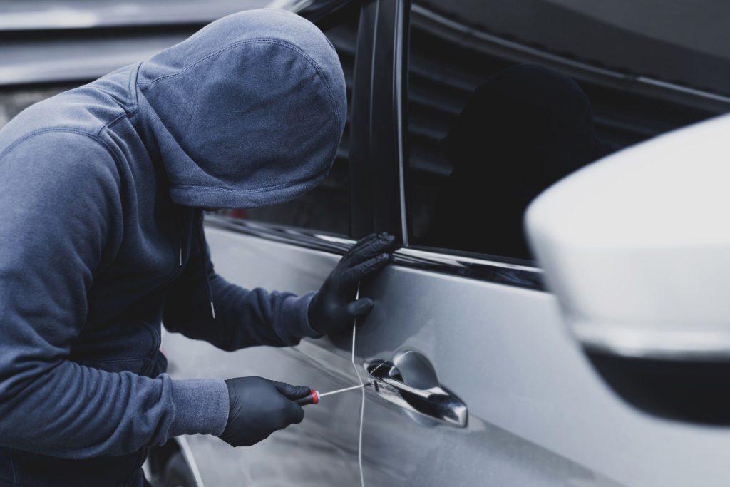 Thief breaking into car/RV.
