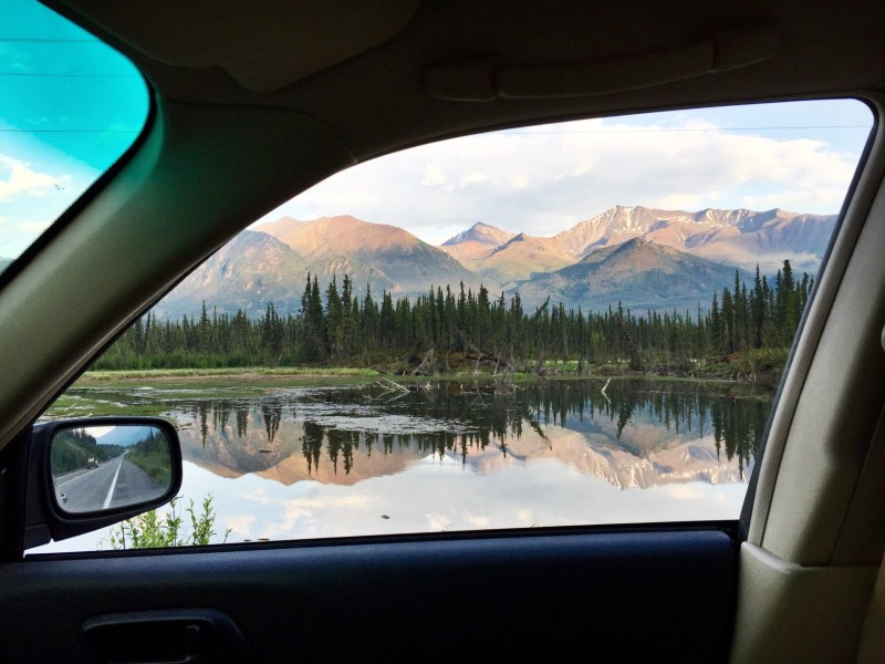 Mountain view out car window in Alaska.