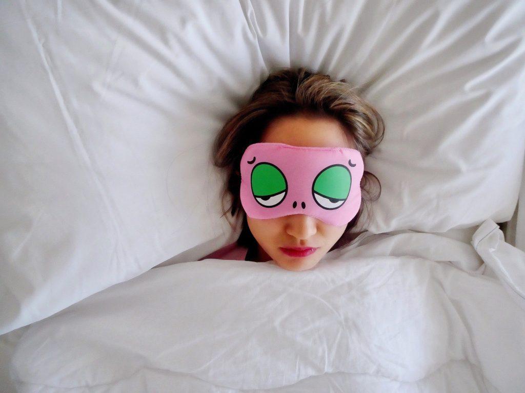 Woman sleeping in a sleep mask.