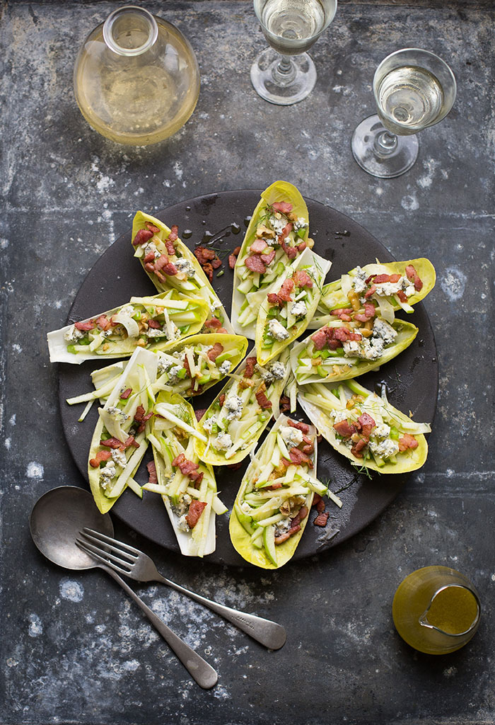 endive (Witlof) salad boats with apple, blue cheese, bacon and walnuts