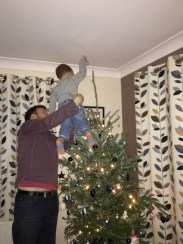 Putting the star on the Christmas tree