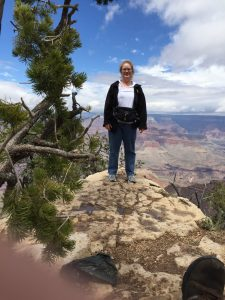 Lea standing at Grand Canyon