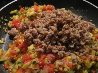 Add Browned Meat to Vegetable Mixture