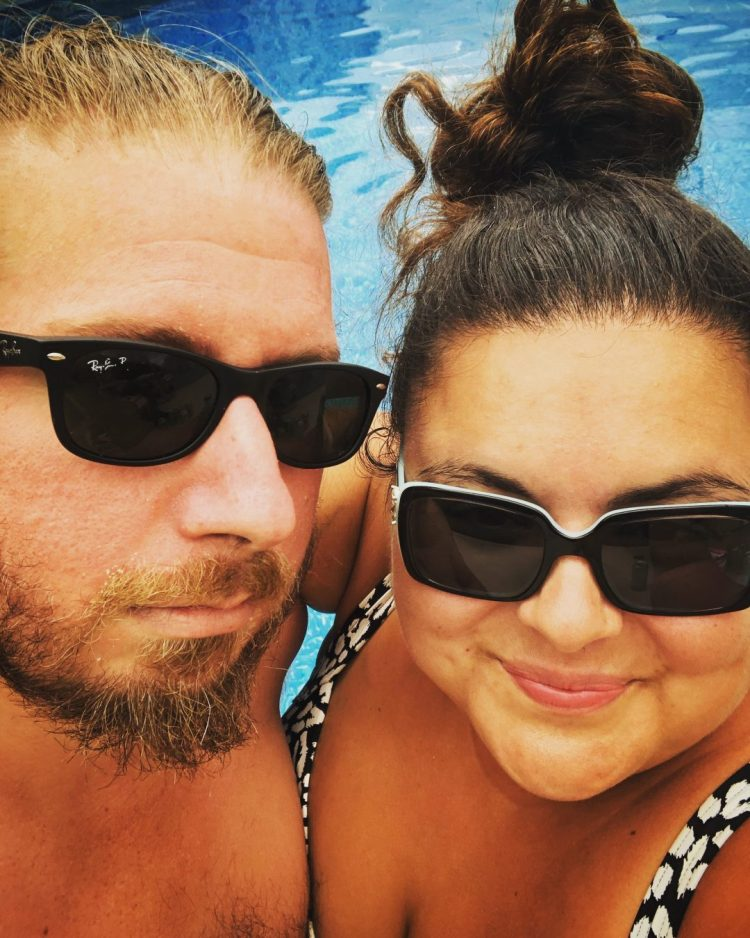 Dr. MC & her husband poolside