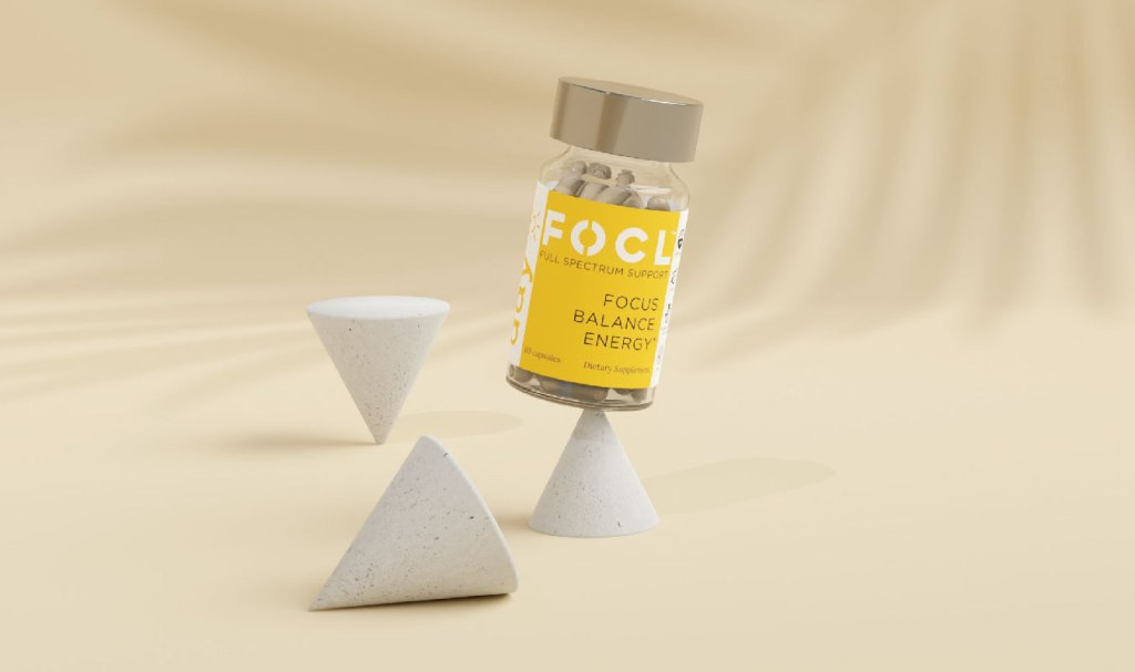 yellow bottle of FOCL full-spectrum CBD oil capsules for focus, balance and energy balancing on top of cone