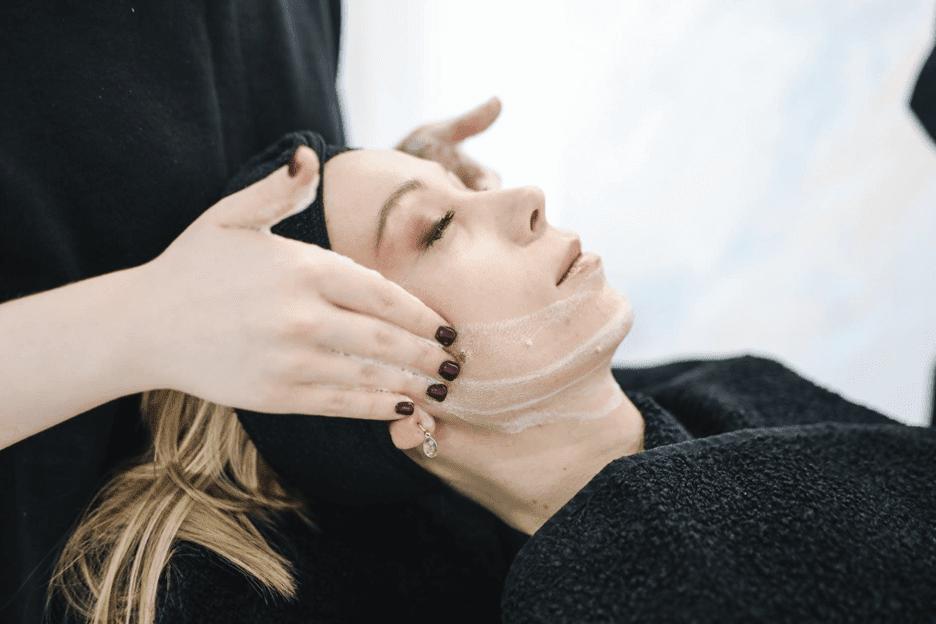 woman at the spa receiving a CBD facial