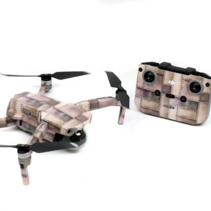 Metallic Rivets Strikes Drone Skin Wrap Decal Stickers for DJI Mavic Air 2 Applied to Drone and Remote Front View