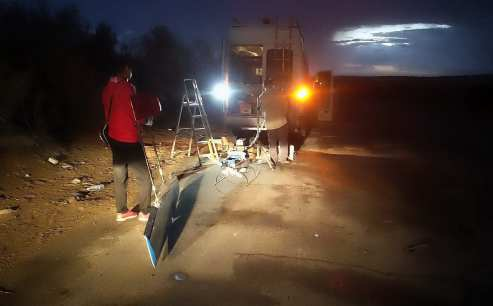 Scientists get prepared in the dawn twillight to fly the UAV.