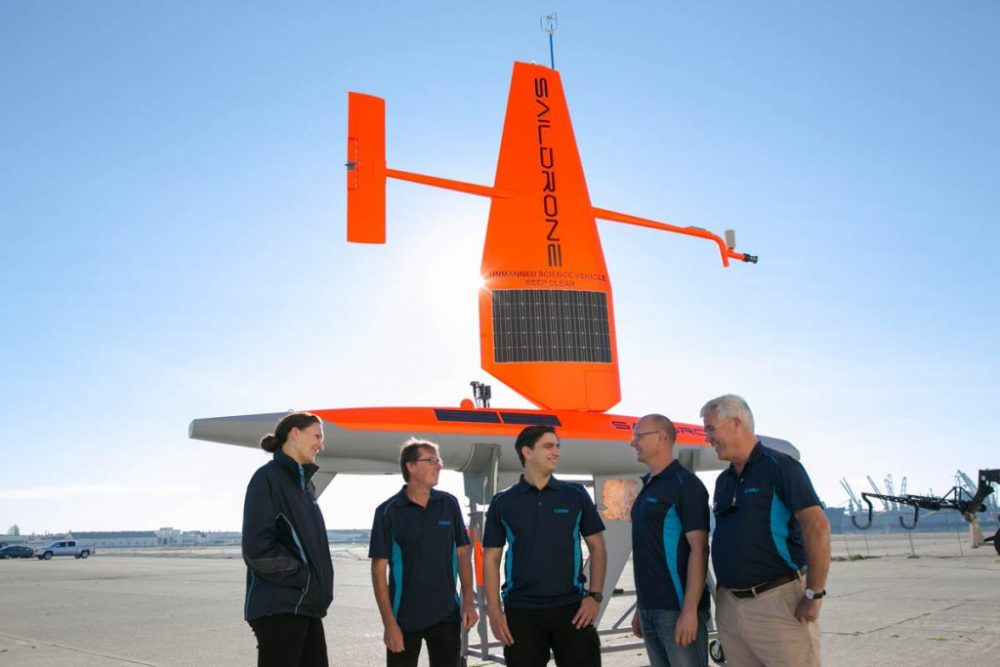CSIRO Oceans and Atmosphere Team with one of the Saildrones.