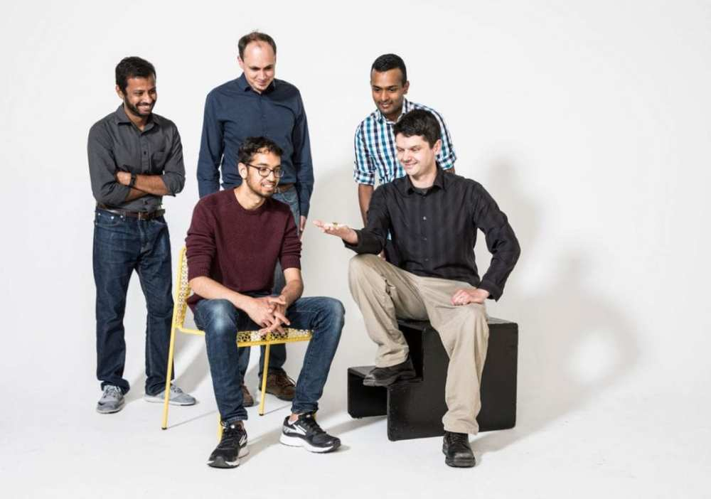 The University of Washington engineers who created RoboFly check out their new tiny wireless flying robot. Back row (left to right): Yogesh Chukewad, Sawyer Fuller, Shyam Gollakota; Front row: Vikram Iyer, Johannes James.Mark Stone/University of Washington