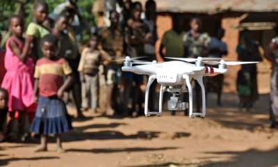 A drone operated by Chief Air Traffic Controller Steve Mkandawire, one of five Civil Aviation certified pilots, takes off during a demonstration for residents in Thipa vllage, Kasungu District, Malawi, Thursday 29 June 2017. Thipa village is 19 kilometres from the nearest health centre in Dwangwa and the only way to get there is either by bicycle or walking for four hours. On 29 June 2017, the Government of Malawi and UNICEF launch an air corridor to test potential humanitarian use of Unmanned Aerial Vehicles (UAVs), also known as drones. The corridor is the first of its kind in Africa and one of the first globally with a focus on humanitarian and development use. It is centred on Kasungu Aerodrome, in central Malawi, with a 40 kilometre radius (80 kilometre diameter) and is designed to provide a controlled platform for the private sector, universities and other partners to explore how UAVs can be used to help deliver services that benefit communities. The UAV corridor will run for at least one year, until June 2018. Since the announcement in December 2016, 12 companies, universities and NGOs from around the world have applied to use the corridor. These include drone manufacturers, operators and telecom companies such as GLOBHE (Sweden) in collaboration with HemoCue and UCANDRONE (Greece), and Precision (Malawi), all of which were present at the launch to demonstrate connectivity, transportation and imagery uses respectively. UAV technology is still in the early stages of development. UNICEF is working globally with a number of governments and private sector partners to explore how UAVs can be used in low income countries. All projects adhere to a strict set of innovation principles, with a focus on open source and user-centred design.