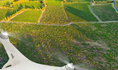 A drone flying above a farm