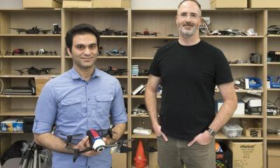 Computing science professor Richard Vaughan (right) and Ph.D. student Sepehr MohaimenianPour (left) are developing technologies in SFU's Autonomy Lab to help users interact with drones in a more intuitive manner.