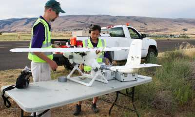 Cory Cantey (left) and Karine Chen prepare the drone, Papaya, for flight.Credit: Autonomous Flight Systems Laboratory