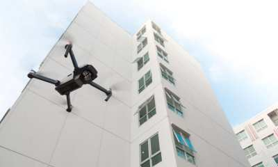 A drone flies near a building