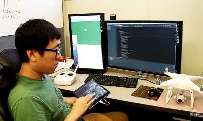 Hao Kang, doctoral student and co-investigator for FlyCam, works on the touch-screen navigation system. (Purdue University photo/High Performance Computer Graphics Lab)
